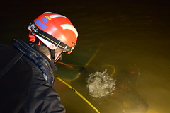 Divers from Specialist Group International (SGI) support firefighters from Surrey Fire and Rescue Service in responding to a boat that had sunk near on the Surrey side of Hampton Court bridge.