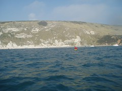 Helen paddling back into Lulworth Cove Image