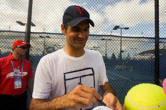 Roger Federer signing autographs