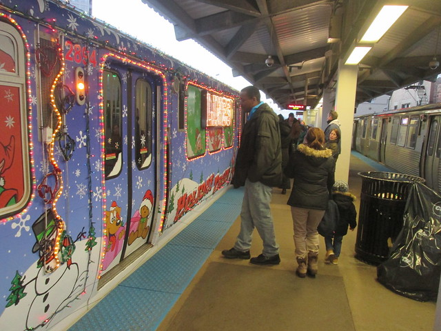 Yellow Line Holiday Train stops at Howard 'L' Station's northbound platform