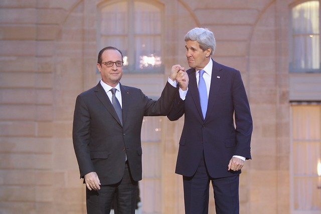 French President Hollande and Secretary Kerry Clasp Hands to Express American Solidarity With the French People from Flickr via Wylio