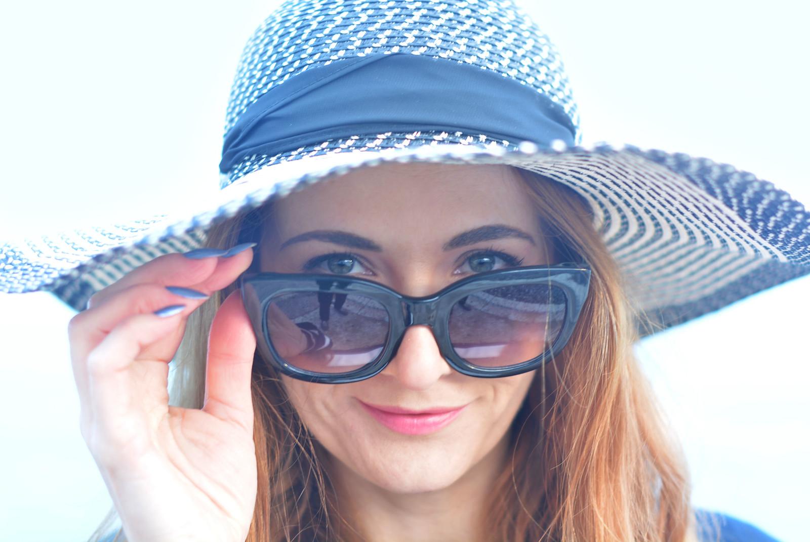 Nautical style: Navy blue and white floppy hat, cat eye sunglasses
