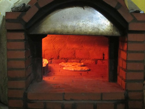 Delicious Pizzas in homemade brick oven