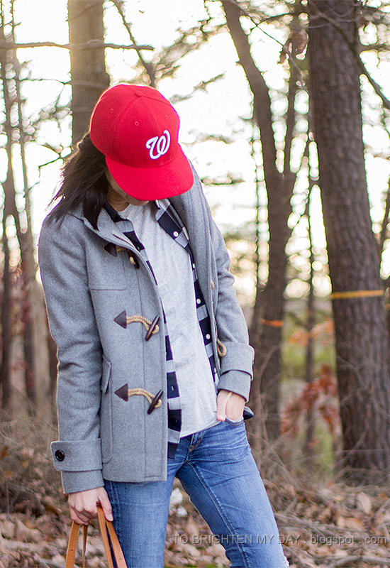 red cap, gray toggle coat, plaid shirt