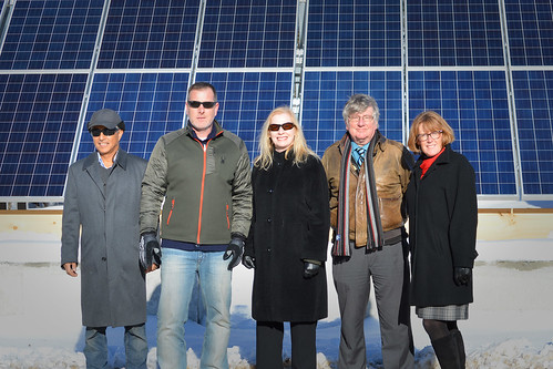 Standing in front of the solar array at Mt. Abram, Maine's first solar-powered ski area are Solar Market Owner Naoto Inoue; Mt. Abram Owner Matthew Hancock; USDA Rural Development State Director Virginia Manuel; Senator Angus King's representative, Ben Tucker; and Senator Susan Collins' representative, Carlene Tremblay.
