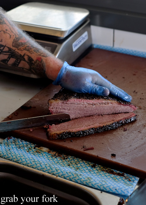 Slicing the beef brisket at Vic's Meat Market at Sydney Fish Market, Pyrmont