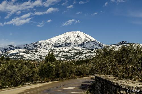 road trees sky mountain snow clouds greece evia steni euboea dirfys