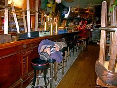 2004_10_11_Alan Sleeping on Bar Stools_3298