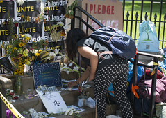 Leaving something at the Philando Castile memorial at the Governor's Mansion
