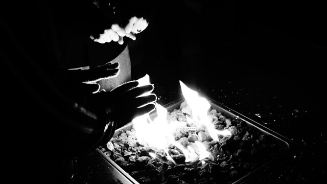 Hands by a fire