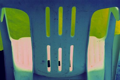 greek white plastic chairs