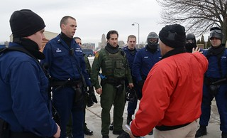 Border Patrol Agent Frank Luna, the lead active shooter exercise instructor, gives instructions to members of the Coast Guard and Border Patrol during an active shooter exercise held at Coast Guard Sector Buffalo, N.Y., Jan. 29, 2015. Members of the police department, Coast Guard and Border Patrol worked together during the exercise that simulated a real-life active shooter event. (U.S. Coast Guard photo by Petty Officer 3rd Class Lauren Laughlin)