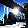Icicles on a #woodrailfence #winter #wintertime #icicles #snow #sunflare #Colorado #ice