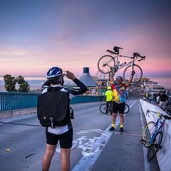 Riders after the @wolfpackhustle #marathonhustleride at #santamonicabeach taking advantage of the beautiful #twilighthour sky with a sense of accomplishment.