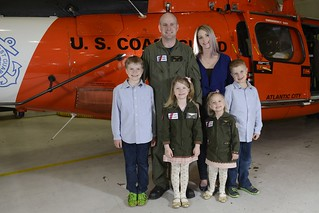 Tiffanie Holt, the ombudsman for Coast Guard Air Station Atlantic City, N.J., poses in front of a helicopter with her family Tuesday, April 1, 2014. The Coast Guard Ombudsman Program aims to enhance communication between the command and Coast Guard family members. (U.S. Coast Guard photo by Petty Officer 2nd Class Cynthia Oldham)