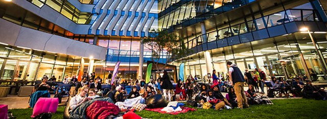 Movies at Jeffrey's – Outdoor cinema with inflatable screen in courtyard outside entrance