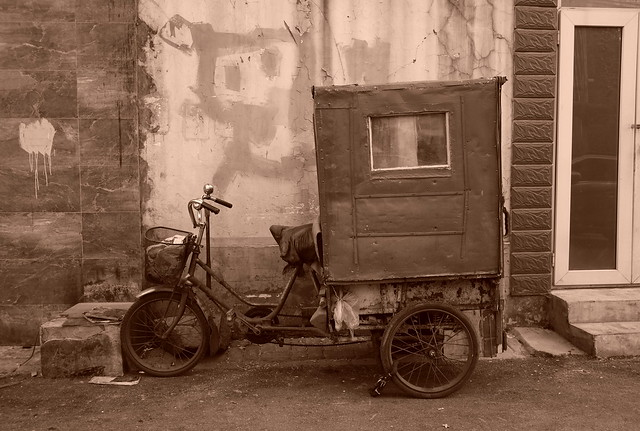 China Beijing hutong backalley with parked trike pedicab (?) -
