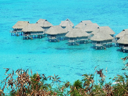 Hotel huts above the water in Moorea - French Polynesia