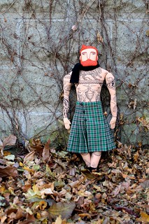 tattooed man- red hair, green kilt