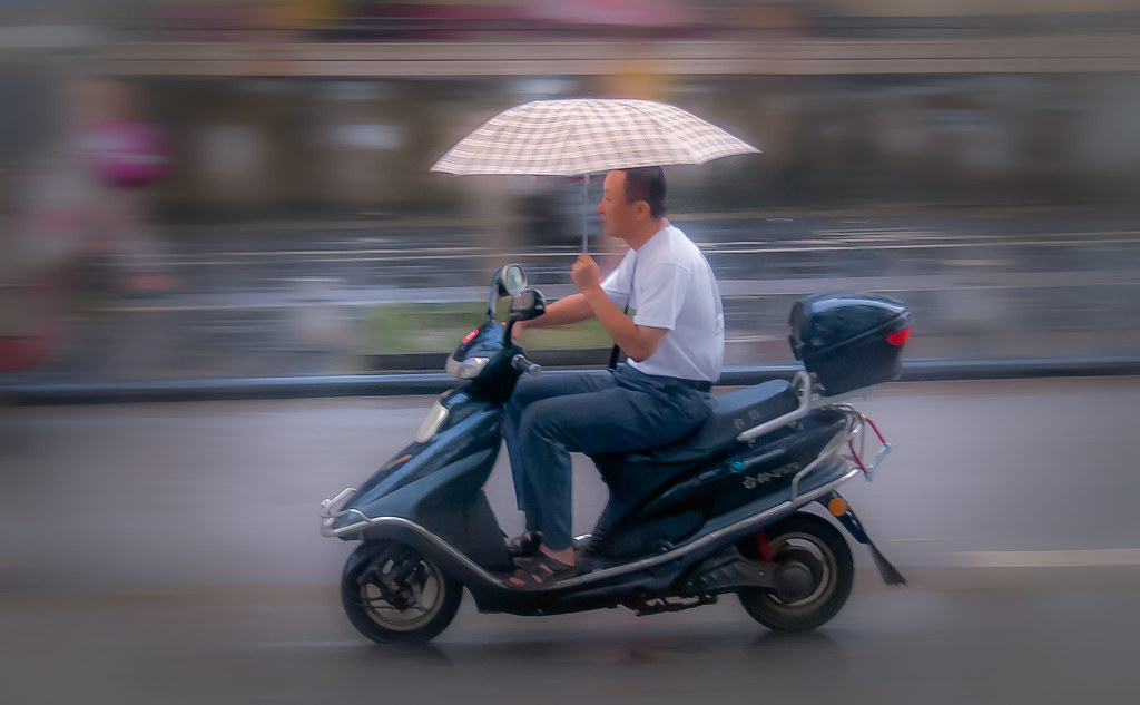 Biker with Umbrella