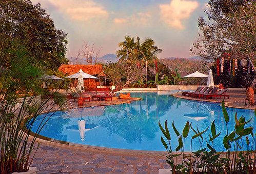 THAILAND - Chiang Rai - Comfortable hotel with pool at sunset