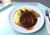 Coiled bratwurst with wine sauerkraut, gravy & mashes potatoes / Bratwurstschnecke mit Weinsauerkraut, Bratensauce & Kartoffelpüree