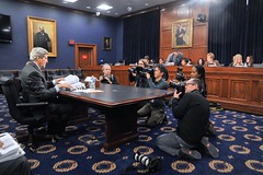 U.S. Secretary of State John Kerry is surrounded by photographers in the Rayburn House Office Building in Washington, D.C., on February 25, 2015, prior to testifying before the House Appropriations Committee on Foreign Operations, and after appearing before the House Foreign Affairs Committee. [State Department photo/ Public Domain]