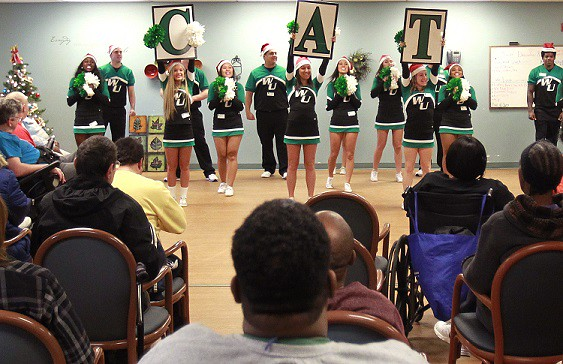 Members of the Wilmington University cheerleading squad cheer and entertain clients at Easter Seals of Delaware in New Castle on December 8, 2014. 