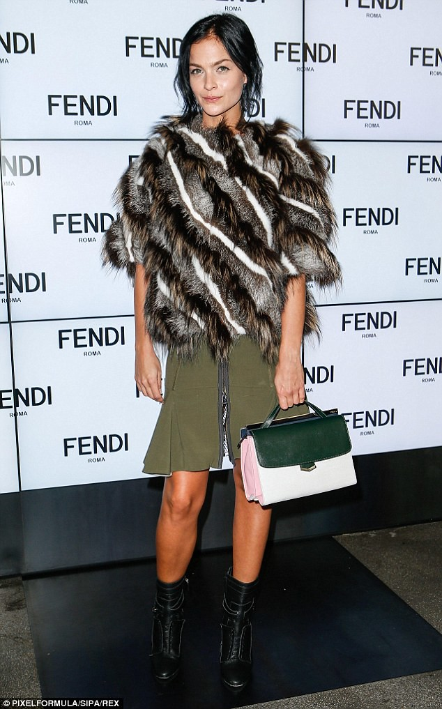 Zip-front-flared-khaki-mini-skirt-with-a-fur-coat,Leather skirt with front zip, How to wear zip front skirts, How to style zip front skirts, side zip skirts
