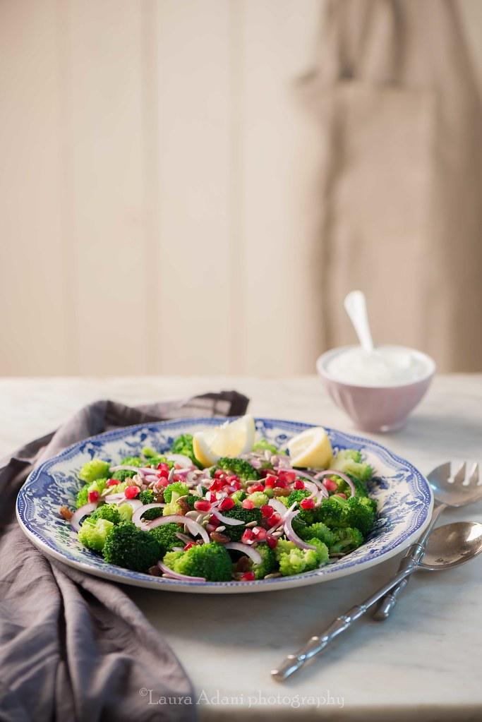 Broccoli salad with raisin, pomegranate and sunflowers seeds