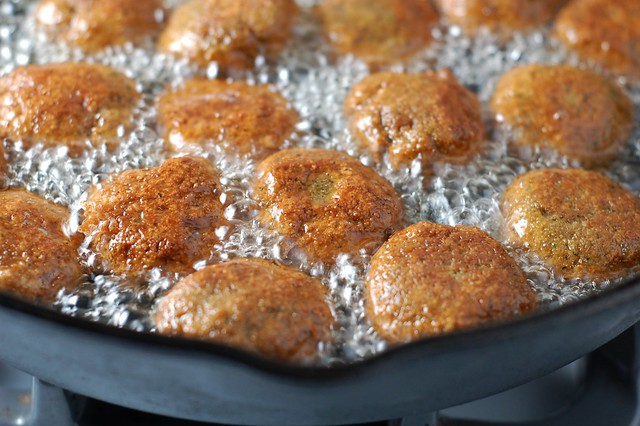 Frying the homemade falafel patties in grapeseed oil by Eve Fox, the Garden of Eating, copyright 2015