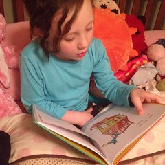 "Teagan reading ""Go Dog Go"" to Stu at bedtime. He only helped with a few words. #soproud #reading #DrSeuss #seuss #sobig #sniff"