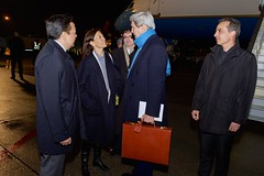U.S. Secretary of State John Kerry speaks with U.S. Ambassador Pamela Hamamoto, Permanent Representative to the United Nations in Geneva, and U.S. Ambassador Keith Harper, Representative of the United States to the United Nations Human Rights Council, after arriving in Geneva, Switzerland, on March 1, 2015, for a bilateral meeting with Russian Foreign Minister Sergey Lavrov, an address to the U.N. Human Rights Council, and to continue negotiations with Iranian officials about the future of their nuclear program. [State Department photo/ Public Domain]