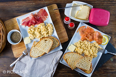 Scrambled eggs with ham and salmon
