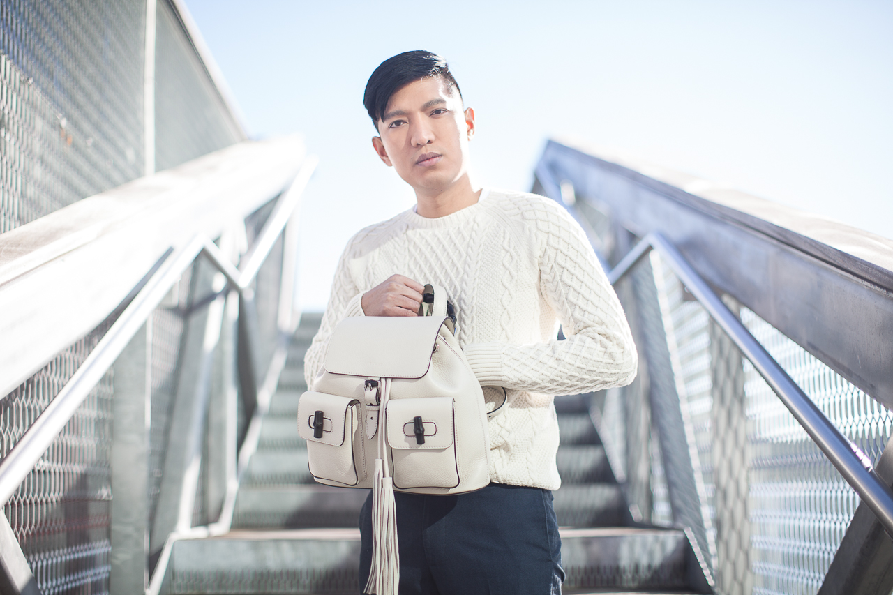 Gucci white backpack with bamboo leather handle worn by Bryanboy