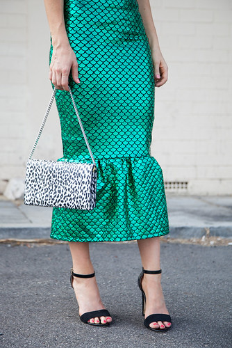Close up of green metallic skirt