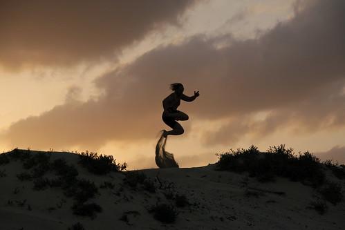 oman arabic peninsule arabia jump jumping sand dune silhouette