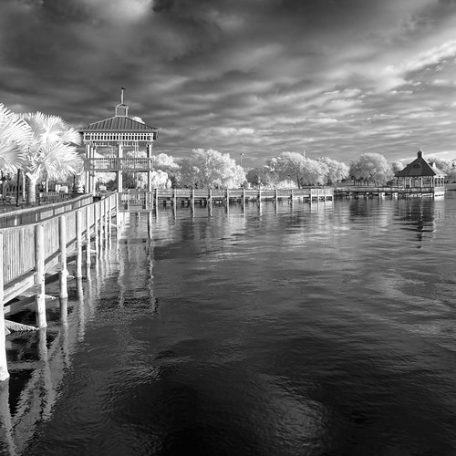 sky blackandwhite bw panorama usa cloud plant reflection tree water monochrome weather architecture fence buildings river landscape ir dock cityscape florida cloudy path structures calm sidewalk infrared manmade cocoa centralflorida flickrexplore buildingandarchitecture othermanmade edrosack