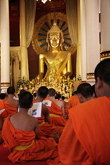 Monks Praying To Buddha In Chiang Mai