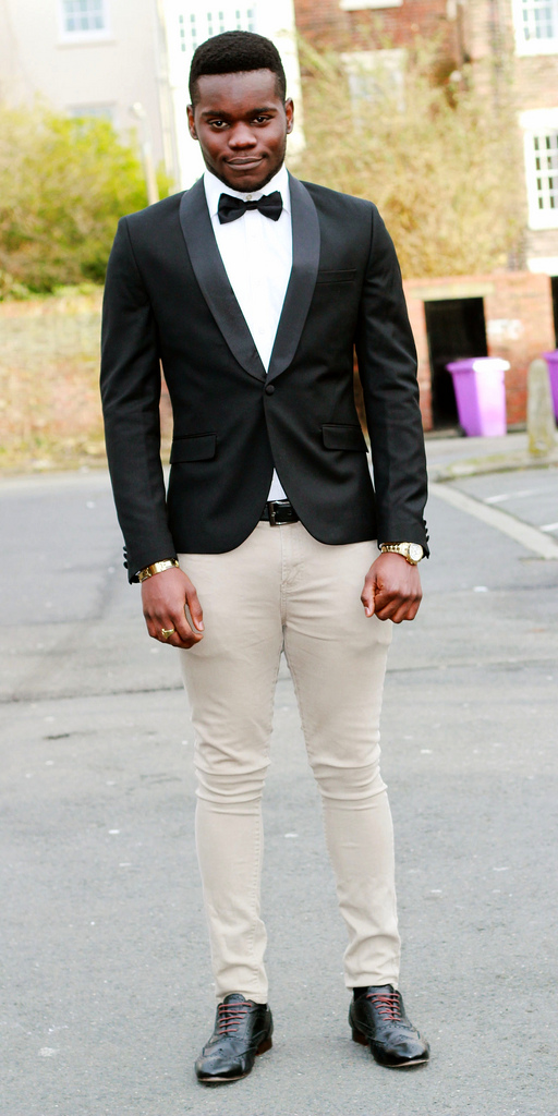 Men&39s black Tuxedo jacket with cream skinny jeans bow tie gold
