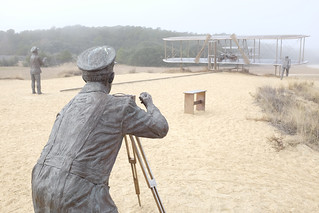 Shown here are statues depicting the Wright Brothers first flight and the surfmen who assisted them.