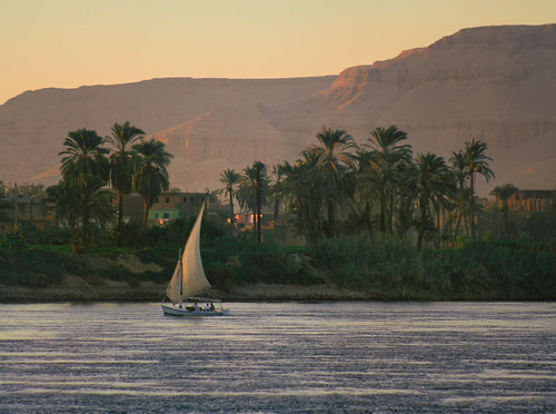 africa sunset summer sky sun nature water smile sunrise river golden boat wind dusk african transport egypt nile adventure egyptian sail leisure recreation mast arabian luxor navigating felucca areyarey