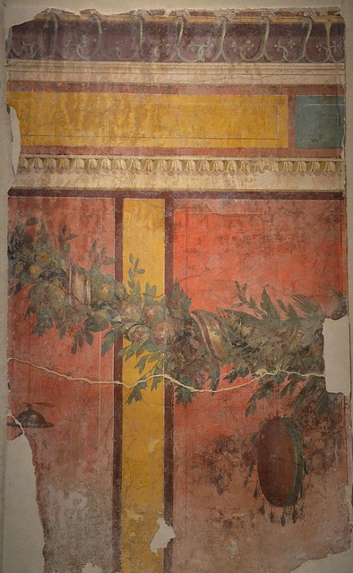 Fresco wall painting with garland of fruits and leaves, cymbalum and tympanum, from the exedra of the Villa of P. Fannius Synistor at Boscoreale, 40–30 BC, Empire of colour. From Pompeii to Southern Gaul, Musée Saint-Raymond Toulouse