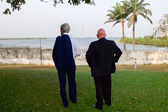 U.S. Secretary of State John Kerry and U.S. Ambassador to Nigeria James Entwistle look out at a lagoon behind the U.S. Consulate General's Residence in Lagos, Nigeria, after the Secretary addressed employees and met with Nigerian President Goodluck Jonathan and his re-election challenger, retired Major-General Muhammadu Buhari, in Lagos on January 25, 2015, for conversations urging both candidates to accept the results of their upcoming general-election vote. [State Department Photo/Public Domain]