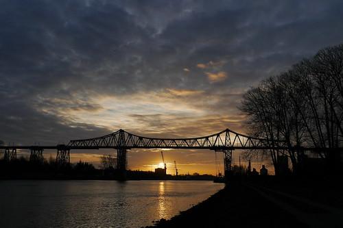 sunrise sonnenuntergang nordostseekanal brücken eisenbahnhochbrücken remndsburg