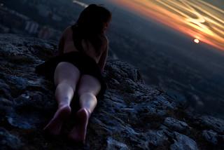 girl. cliff. astronomy.