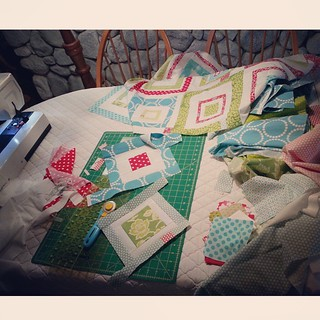 Visiting the grandparents for spring break and I've commandeered the dining room table for sewing. My goal: to make eight more square in a square blocks for my #redandaquabee quilt.