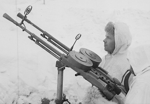 Finnish soldiers in winter camouflage with captured Soviet 7.62 mm MGs