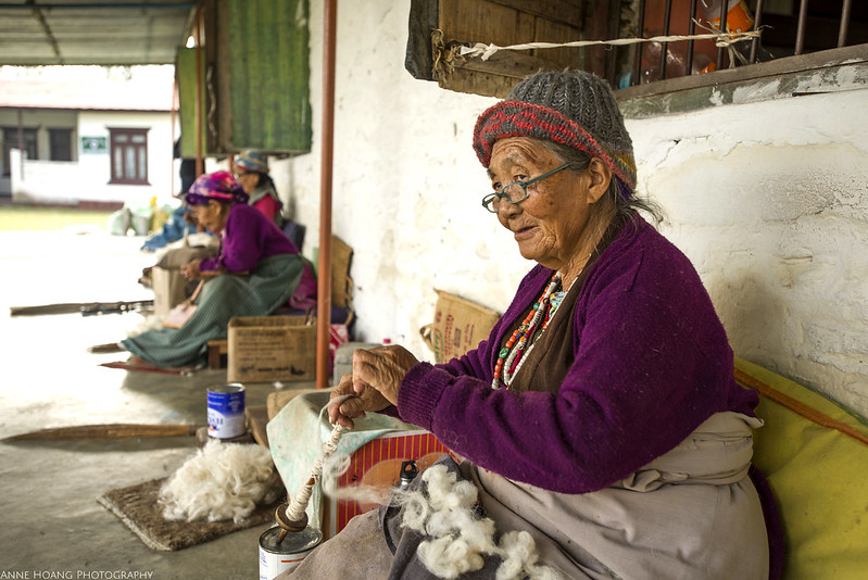Tibetan woman spins wool
