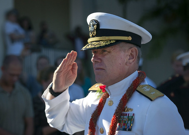 PEARL HARBOR - Rear Adm. Rick Williams, commander of Navy Region Hawaii and Naval Surface Group Middle Pacific, salutes as he walks through an honor cordon of military service members during the 73rd anniversary Pearl Harbor Day commemoration ceremony at the Pearl Harbor Visitor Center.